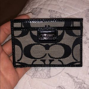 Black and grey Coach credit card and ID holder